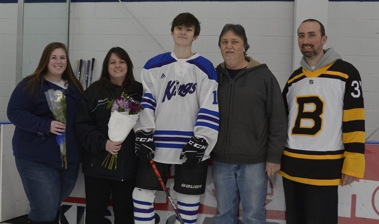 Hockey player with parents