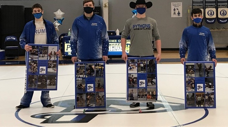 4 boy wrestlers with posters