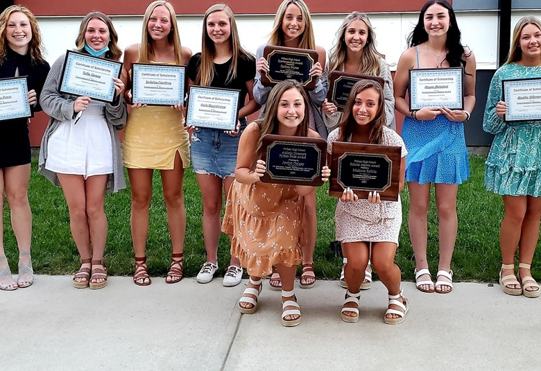 Girls with plaque awards