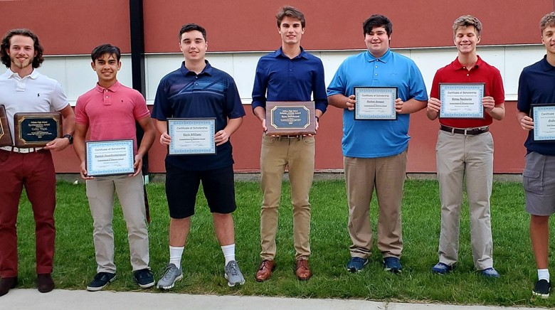 Boys with plaque awards