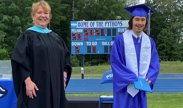 Boy with principal at graduation
